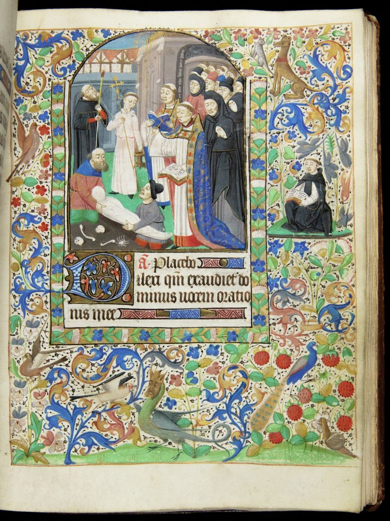Medieval illuminated manuscript showing the burial of a person wrapped in a white shroud. Two men lower this person into the ground, while two preists read from books and mourners stand in the background.